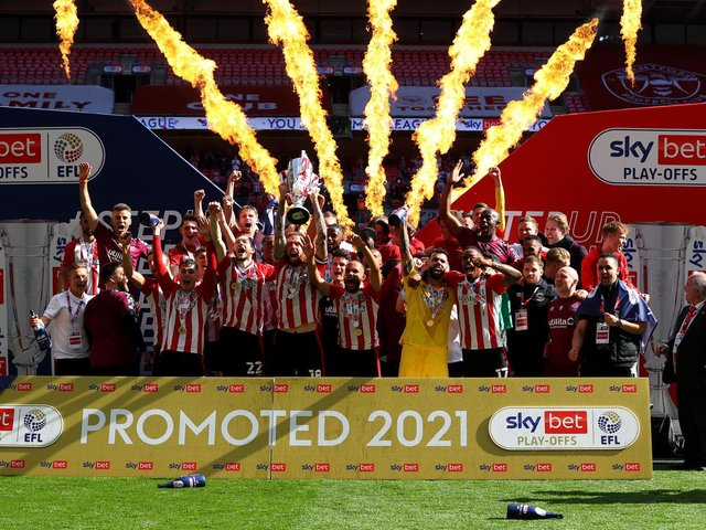 Brentford captain Pontus Jansson lifts Championship play-off final trophy at Wembley. Pic: Getty