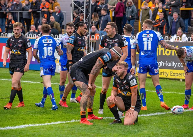 George Griffin and Danny Richardson show their fustration during Castleford Tigers's 60-6 defeat to Leeds Rhinos on Friday. Picture: Bruce Rollinson.
