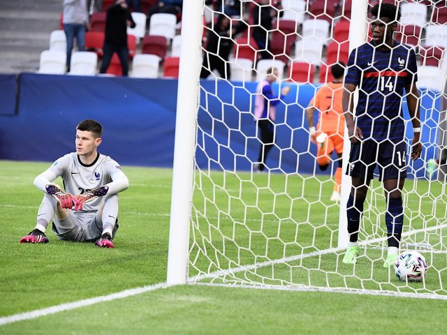 LATE DESPAIR: For Leeds United goalkeeper Illan Meslier, left, and France's under-21s after defeat to the Netherlands in Budapest. Photo by ATTILA KISBENEDEK/AFP via Getty Images.
