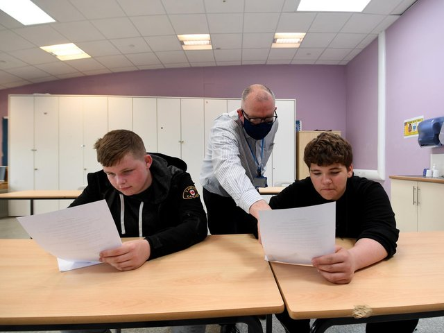 Teacher Ben Powell, who retrained following a career in journalism with a view to a posting at Southway is pictured with students Corey Watson (left) and Lewis Harrison.