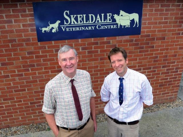 Peter Wright (left) with his former colleague Julian Norton outside Skeldale Veterinary Practice