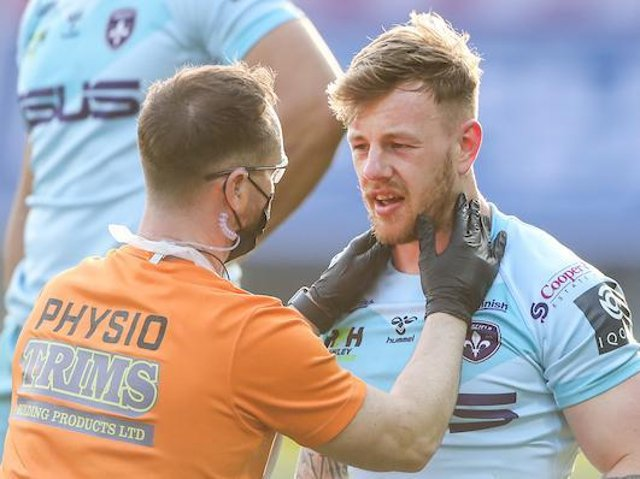 Tom Johnstone is treated after suffering a head injury against Wigan in April. Picture by Alex Whitehead/SWpix.com.