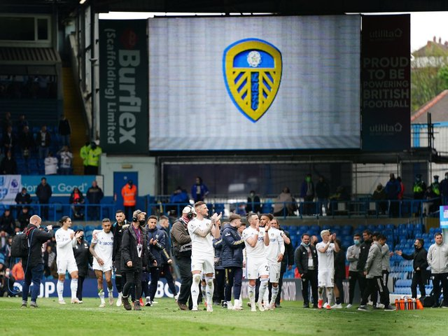 BACK WITH A BANG: Leeds United applaud their fans in the Elland Road stands after their season finale victory against West Brom. Photo by JON SUPER/POOL/AFP via Getty Images.