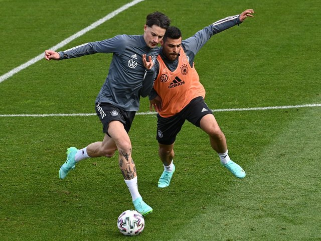 WARMING UP: Leeds United's Robin Koch, left, pictured battling it out with midfielder Kevin Volland in a Germany training session on Saturday, could be in action for his country tonight. Photo by CHRISTOF STACHE/AFP via Getty Images.