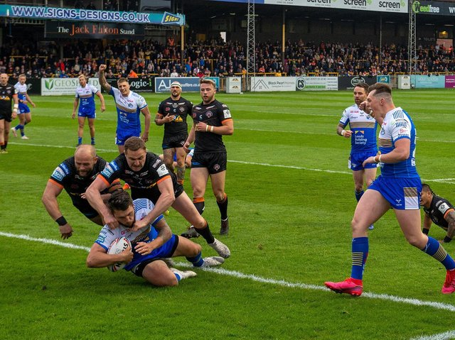 Tom Briscoe scores the first of his two tries in Rhinos' big win at Castleford. Picture by Bruce Rollinson.