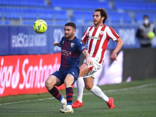 LEFT BACK TALENT: Huesca defender Javi Galan, left. Photo by Alex Caparros/Getty Images.