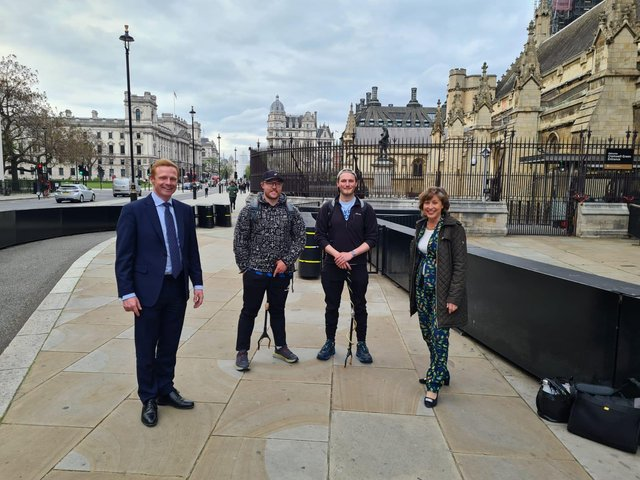 Pictured from left to right: Robbie Moore MP, Wharfe Walkers Patrick Godden and Jack Hanson, and Environment Minister Rebecca Pow MP, outside the Houses of Parliament.