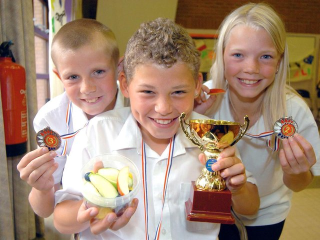 Kalvin pictured alongside Whingate Primary School classmates Peter Hogan and Kirsten Richards in 2007.