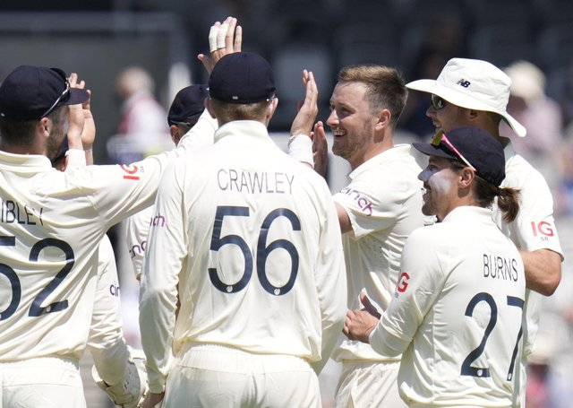 BREAKTHROUGH: England's Ollie Robinson, second from right, celebrates taking the wicket of New Zealand's Colin de Grandhomme. Picture: Kirsty Wigglesworth.