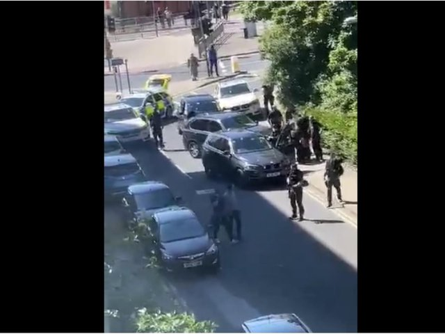 Armed police arrested a man on suspicion of a shooting in Leeds after stopping a car at Leeds docks.