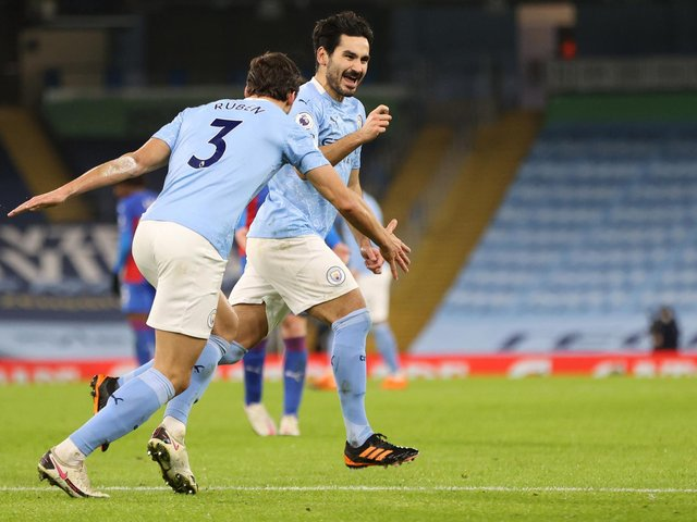 BOTH IN: Manchester City duo Ilkay Gundogan, right, and Ruben Dias, left, as part of six City players in the PFA Premier League team of the year for 2020-21. Photo by Clive Brunskill/Getty Images.
