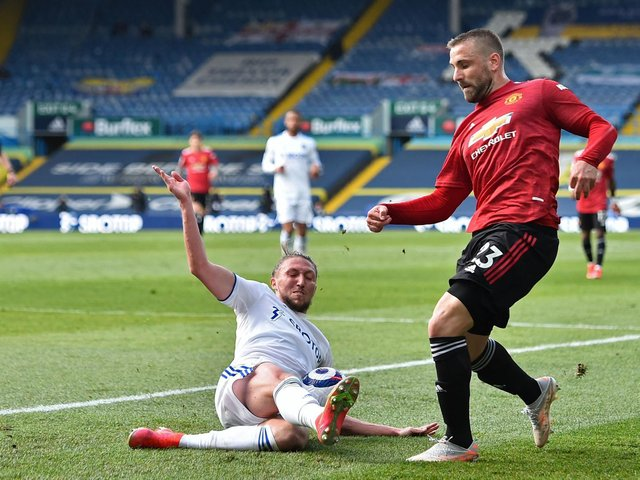 ONE IN, ONE NOT: Leeds United defender Luke Ayling challenges Manchester United's Luke Shaw in April's Premier League clash at Elland Road. Shaw has made the England squad but Ayling hasn't. Photo by PETER POWELL/POOL/AFP via Getty Images.