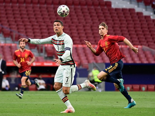BACK IN ACTION: Leeds United centre-back Diego Llorente, right, chasing Portugal's Cristiano Ronaldo in Friday night's friendly in Madrid. Photo by JAVIER SORIANO/AFP via Getty Images.