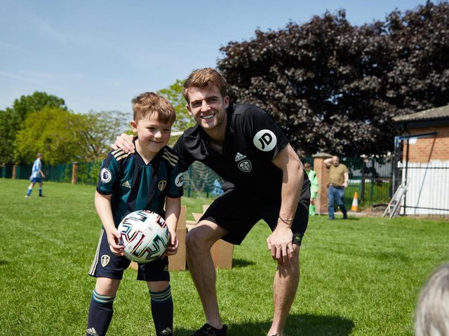 Leeds United striker Patrick Bamford with a young fan during his visit to Beeston Juniors. Pic: Leeds United