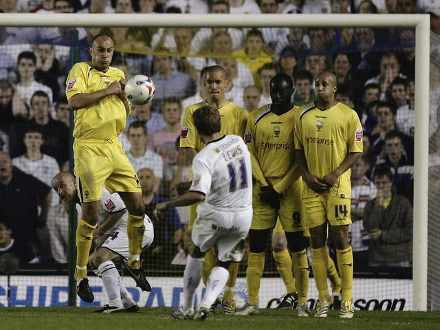 BEAUTY: Leeds United's Eddie Lewis puts his free-kick into the top right corner in the Coca-Cola Championship semi-final first leg play-off against Preston North End at Elland Road on May 5, 2006. Photo by Alex Livesey/Getty Images.