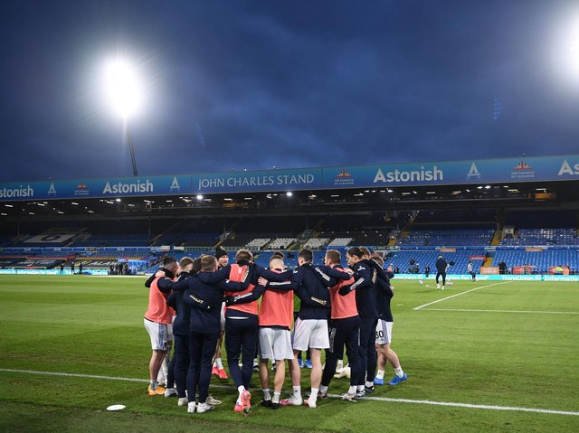 Leeds United players huddle at Elland Road ahead of kick-off. Pic: Getty