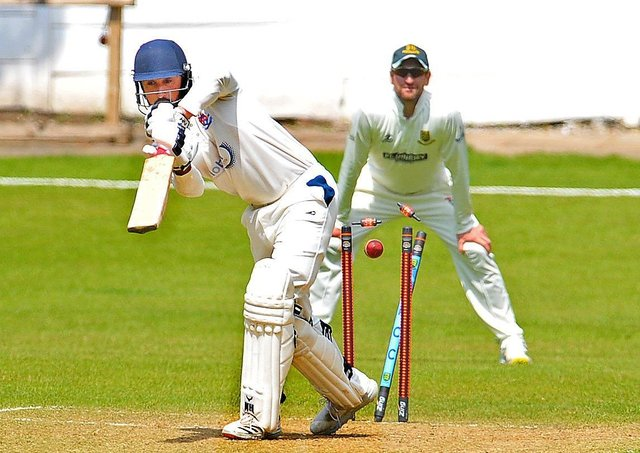 Batley's Abdul Wahid is bowled by New Farnley's Sam Lodge for 13. Picture: Steve Riding.