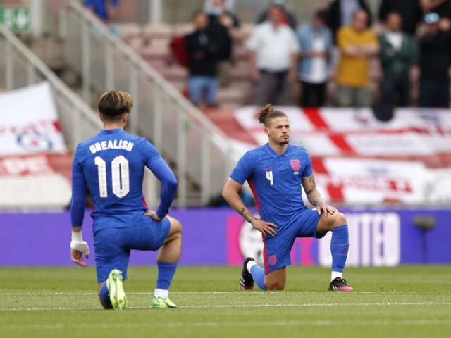 BACK IN THE SIDE: Leeds United's England international midfielder Kalvin Phillips takes a knee before Sunday's friendly against Romania at the Riverside. Picture by Lee Smith/PA Wire.
