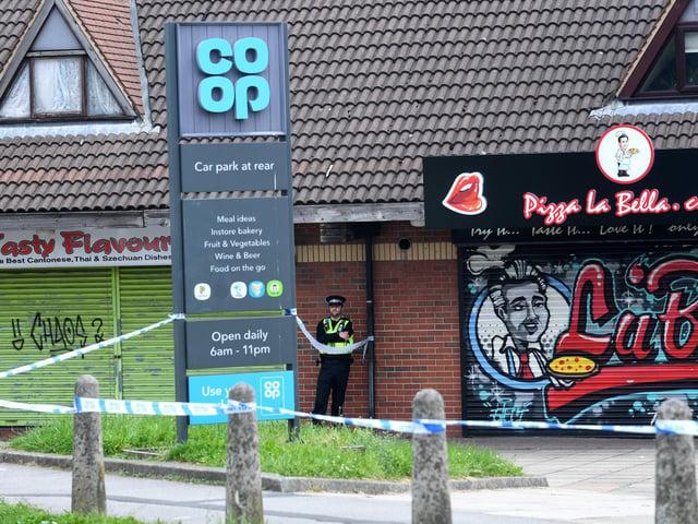 The police cordon outside Swinnow Shopping Centre.