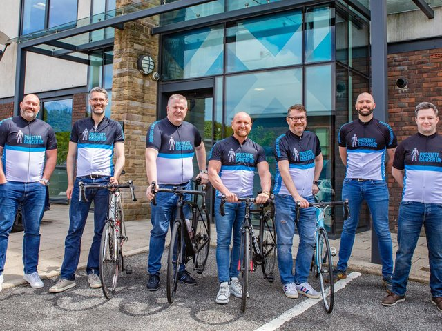 Some of the workmates at Romero Group who are preparing for a coast-to-coast bike ride in memory of former colleague Lloyd Pinder, who lost his battle with prostate cancer last year.