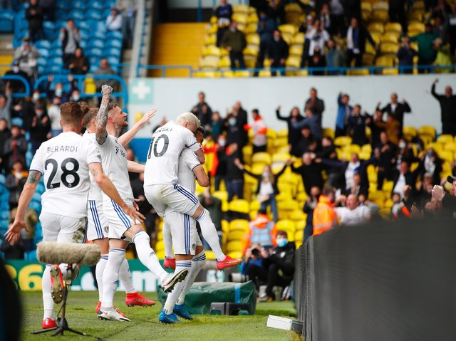 Leeds United players celebrate with fans at Elland Road. Pic: Getty