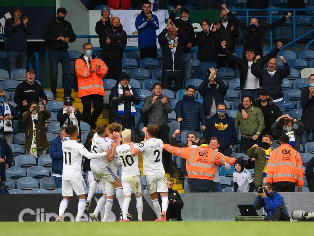 Leeds United's players celebrate with supporters at Elland Road. Pic: Getty