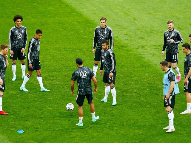BENCH VIEWING: For Leeds United defender Robin Koch, second right, pictured as Germany warm up for Monday night's friendly against Latvia in Dusseldorf. Photo by THILO SCHMUELGEN/POOL/AFP via Getty Images.