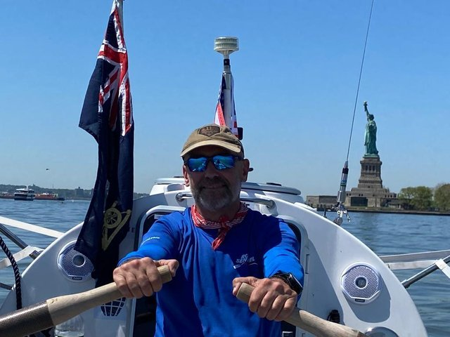 Ian Rivers leaves the backdrop of New York with the Statue of Liberty in the background.