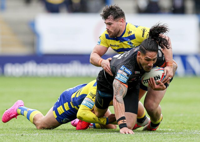 Castleford Tigers' Jesse Sene-Lefao is tackled by Warrington Wolves' Gareth Widdop and Joe Philbin during the Challenge Cup semi-final. Picture: Paul Currie/SWpix.com.