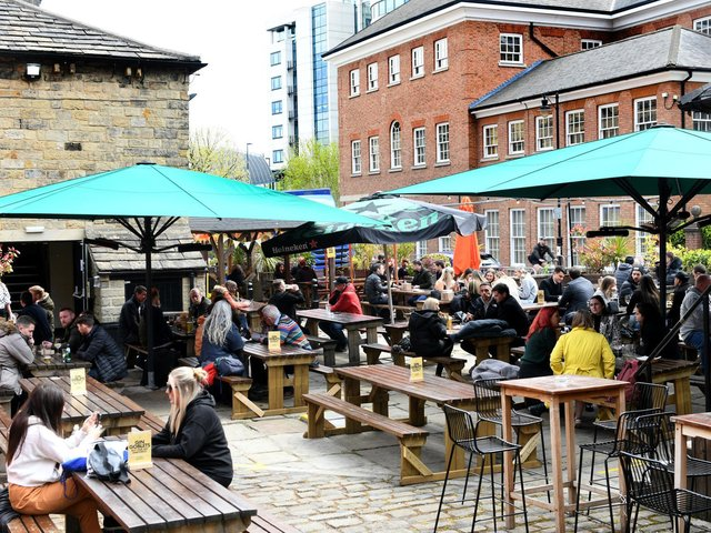 Pictured: Friends enjoying food and drink outside at Water Lane Boathouse, one of many fantastic venues in Leeds.