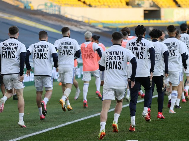 Leeds United display 'earn it' t-shirts in response to the Super League earlier this season. Pic: Getty