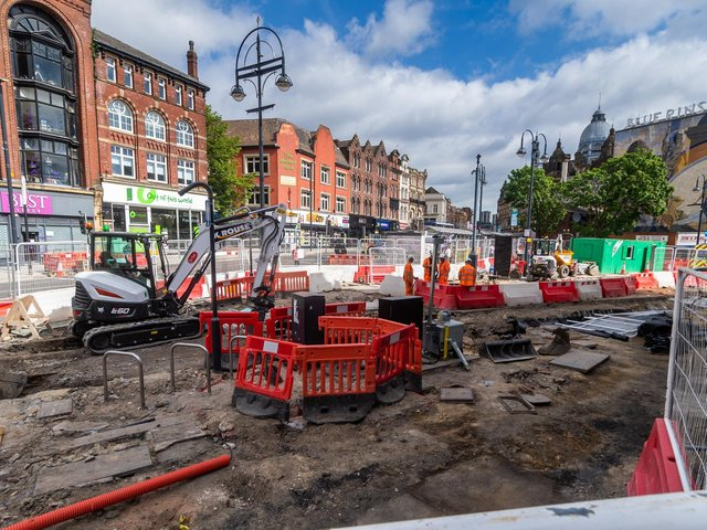 Excavations beneath the road surface near Leeds Corn Exchange have exposed old tram tracks that once ran through the city.