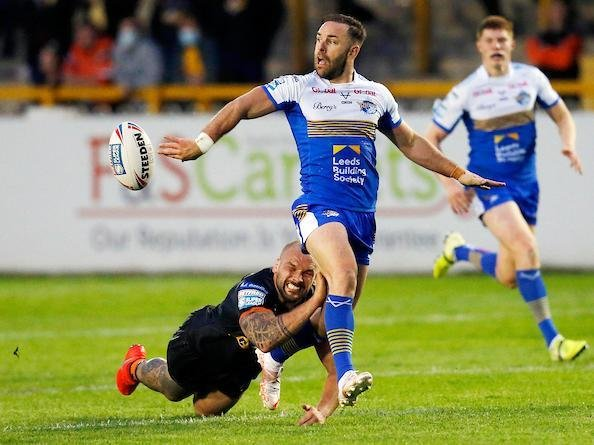 Luke Gale offloads out of a tackle by Geiorge Griffin during Leeds' win at Castleford two weeks ago. Picture by Ed Sykes/SWpix.com.