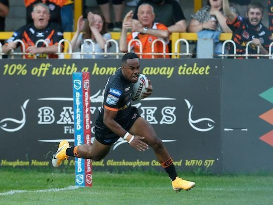 Tigers debutant Jason Qareqare scores with his first touch against Hull. Picture by Ed Sykes/SWpix.com.