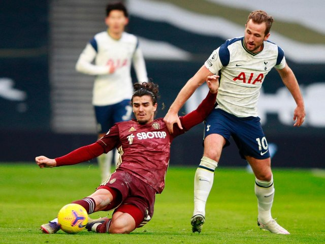 BATTLING THE BEST: Leeds United's Pascal Struijk, left, locks horns with England captain Harry Kane in January's Premier League clash at Tottenham Hotspur. Photo by IAN WALTON/POOL/AFP via Getty Images.
