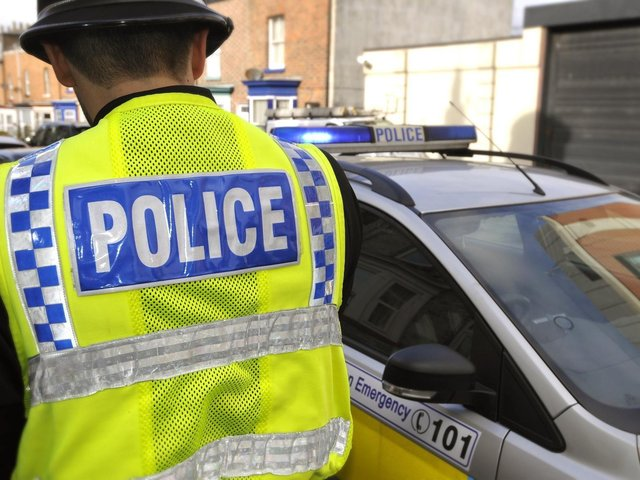 Two men have been arrested after an attack in Farsley. Stock photo of police.
