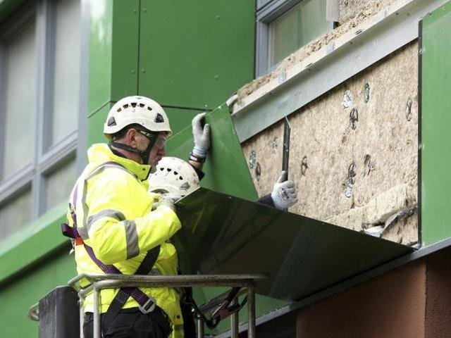 A workman in Sheffield replacing cladding. (Pic: SWNS)