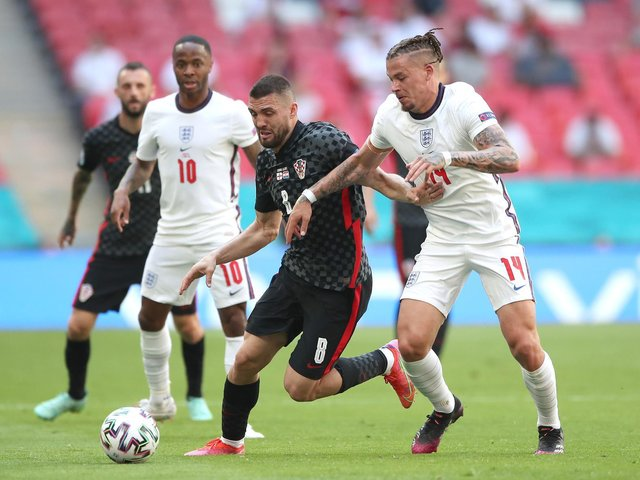 Croatia's Mateo Kovacic (left) and England's Kalvin Phillips battle for the ball during the UEFA Euro 2020 Group D match at Wembley Stadium, London. Picture date: Sunday June 13, 2021 (photo: PA).