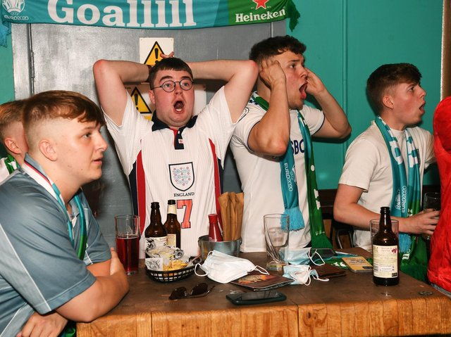 England fans watch the England v Croatia match in the Aire Bar, Leeds.  Picture : Jonathan Gawthorpe