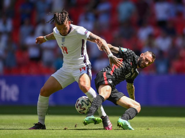 IN THE WAY: Leeds United's England international midfielder Kalvin Phillips, left, battles for possession with Croatia's Marcelo Brozovic during Sunday's Euro 2020 Group D opener at Wembley. Photo by Laurence Griffiths/Getty Images.