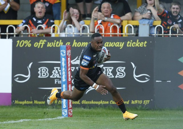 Sensational start: Castleford's teenage winger Jason Qareqare scores less than a minute into his debut against Hull. Picture by Ed Sykes/SWpix.com