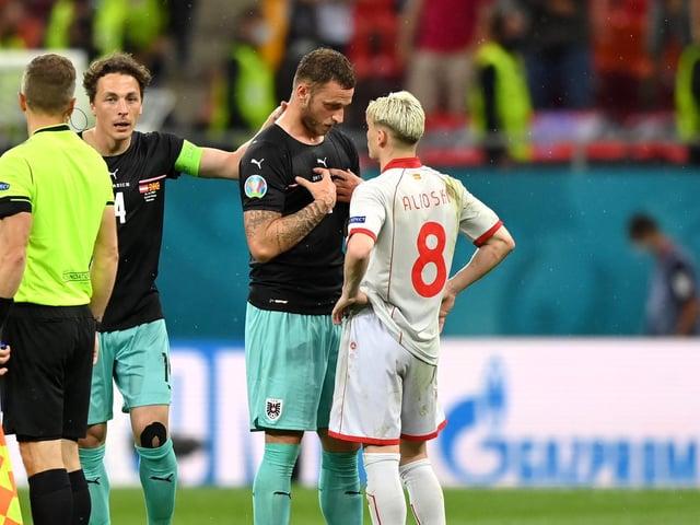 Marko Arnautovic and Gjanni Alioski exchange words following Austria's win over North Macedonia. Pic: Getty