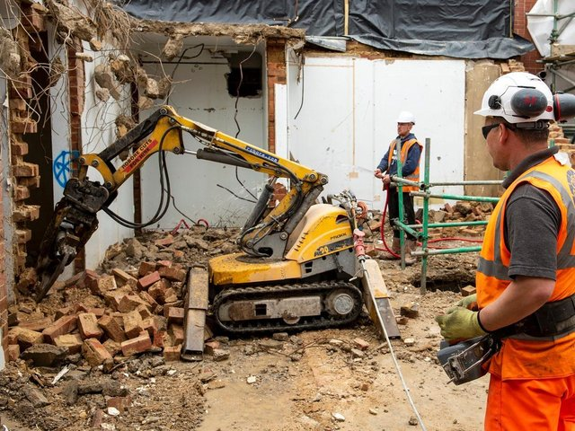Demolition work using remote-controlled small machines on the Old Nurses Home close to LGI's Jubilee Wing.