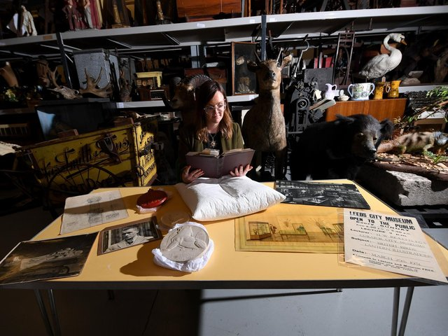 Archivist Errin Hussey with objects at Leeds Discovery Centre (photo: Simon Hulme)