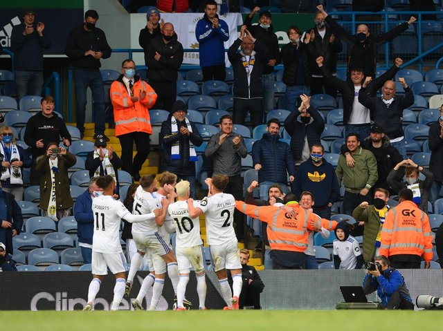 Leeds United celebrate with fans at Elland Road. Pic: Getty