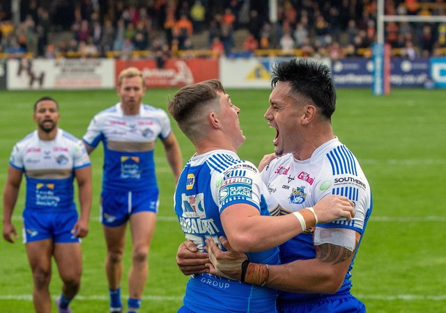 Jack Broadbent: Celebrating scoring the Rhinos second try atCastleford but now the Leeds players are sidelined by Covid.  Pictures: Bruce Rollinson