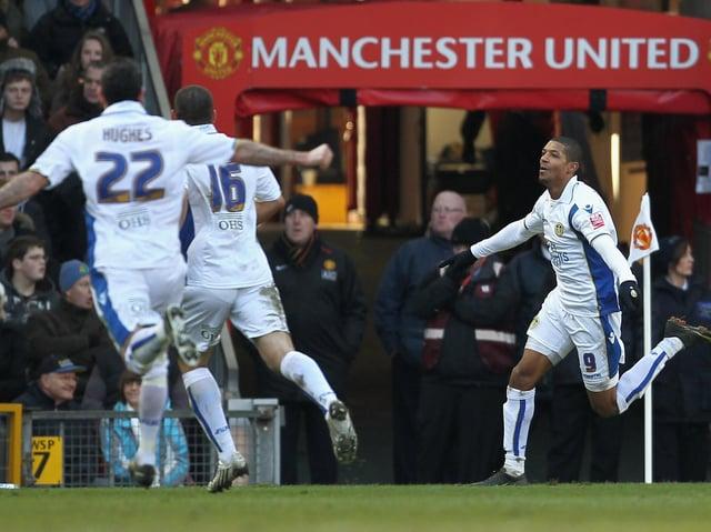 Leeds United striker Jermaine Beckford celebrates at Old Trafford in 2010. Pic: Getty