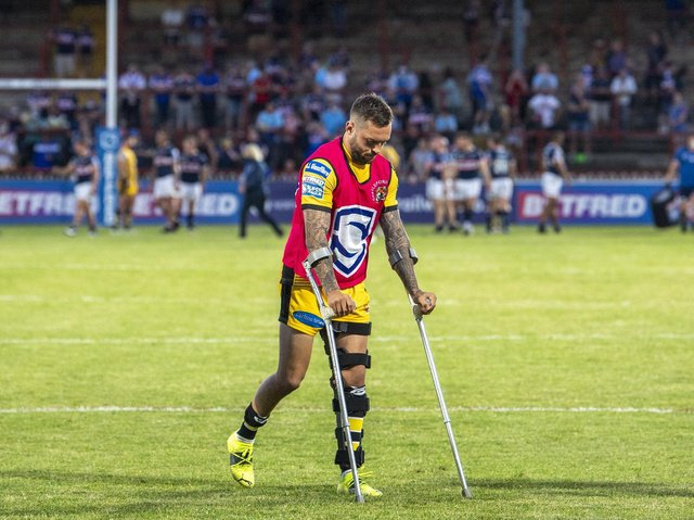 Gareth O'Brien on crutches, with his left knee in a brace, following Wednesday's game. Picture by Tony Johnson.