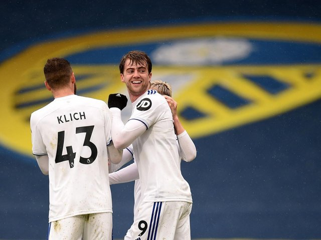 ALL SMILES: Whites striker Patrick Bamford, centre, celebrates his strike against Tottenham in the 3-1 victory at Elland Road in May. Photo by OLI SCARFF/POOL/AFP via Getty Images.