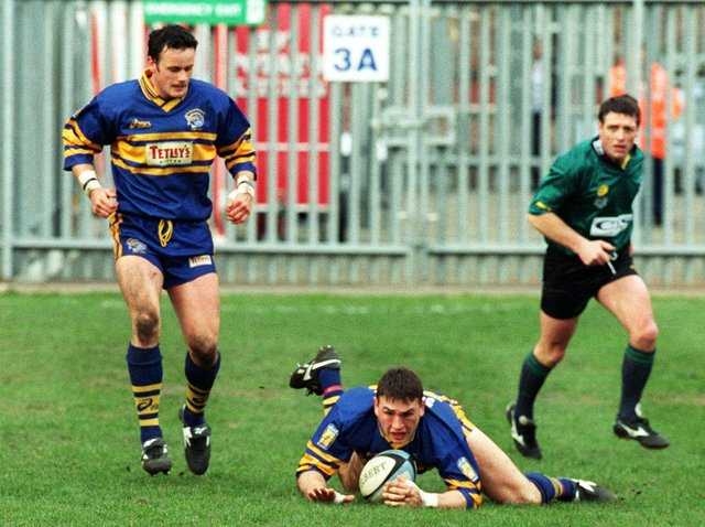 Francis Cummins, left, looks on as Kevin Sinfield scores agianst Widnes in 1999. Picture by Gary Longbottom.